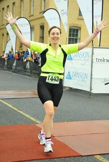 Sarah finishing the triathlon.