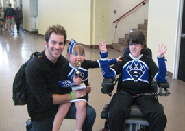 Tommy and Jeffrey Johnson with Madison holding trophy. Jeffrey is doing the Cheer Athletics 'Claw'.