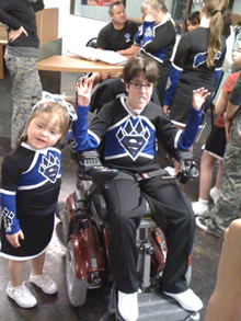 Jeffrey and Madison trying out the new uniforms and shoes.