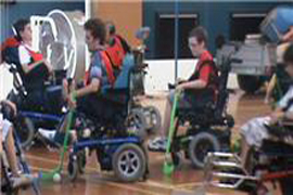 Zac playing wheelchair sport.