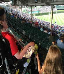 Myo at Wrigley Field with the Bushey family.