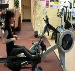 Elly on rowing machine.