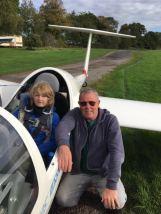 Milosz sitting in glider.