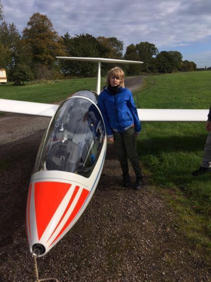 Milosz standing next to glider.