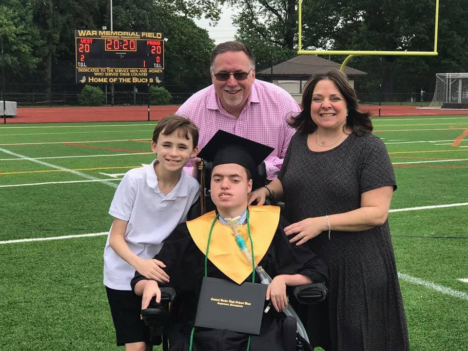 Corey and family on graduation day.