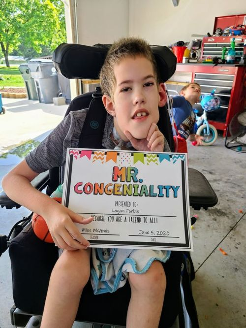 Logan with Mr Congeniality certificate.